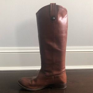 Tall Frye brown boots.